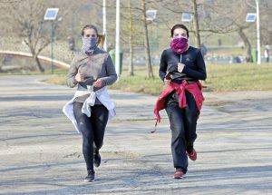 Women running with masks